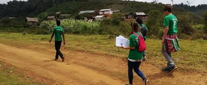 A photo of internship students from Projects Abroad handing out posters to raise awareness during their public health work experience in Madagascar.